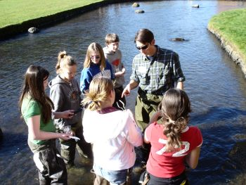students in a pond observing the water