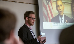 "Maxwell Mensinger '13 gives his presentation, ""Finish Him: The Ethical Implications of Drone Warfare,"" during SSRD April 17."