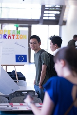 Students explore a poster session examining European integration in Ford Hall.